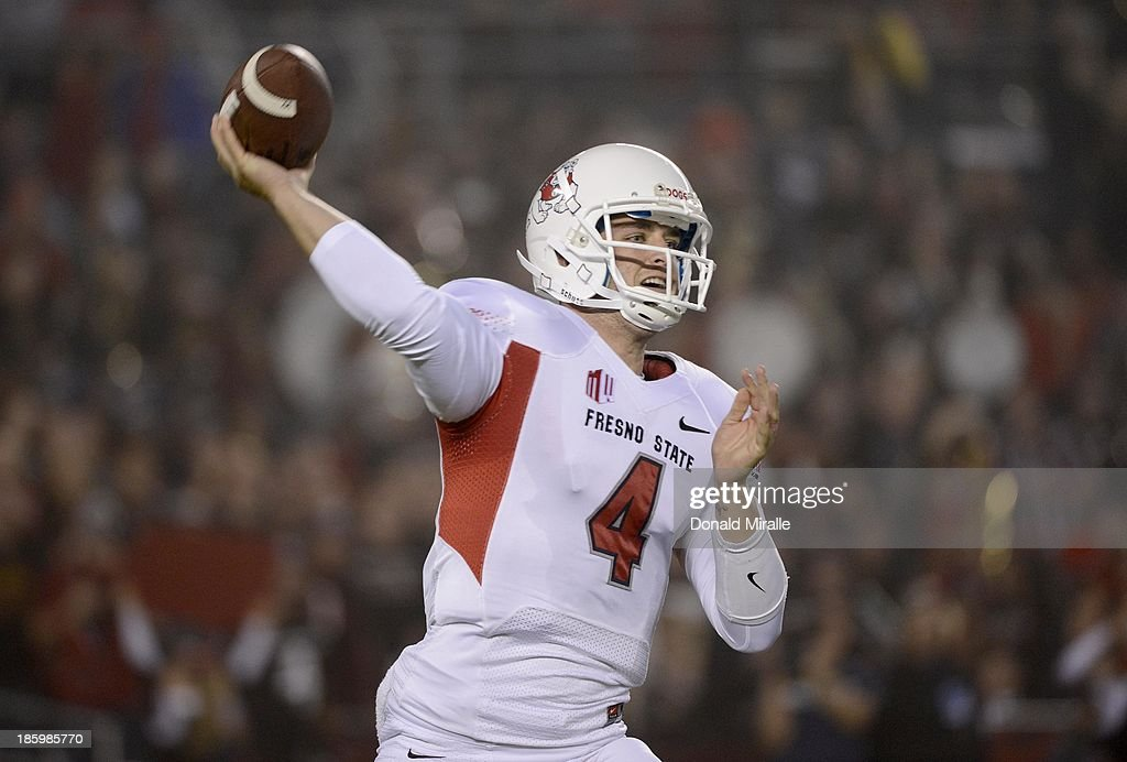 <a gi-track='captionPersonalityLinkClicked' href=/galleries/search?phrase=Derek+Carr&family=editorial&specificpeople=8222798 ng-click='$event.stopPropagation()'>Derek Carr</a> #4 of the Fresno State Bulldogs throws the ball against the San Diego State Aztecs during their game on October 26, 2013 at Qualcomm Stadium in San Diego, California.