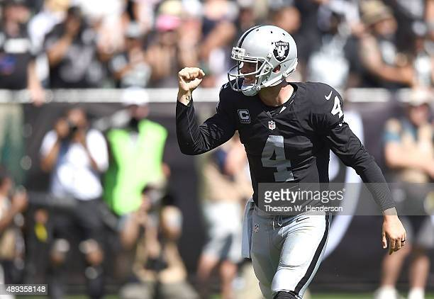 Derek Carr of the Oakland Raiders celebrates a touchdown in the second quarter against the Baltimore Ravens at OaklandAlameda County Coliseum on...