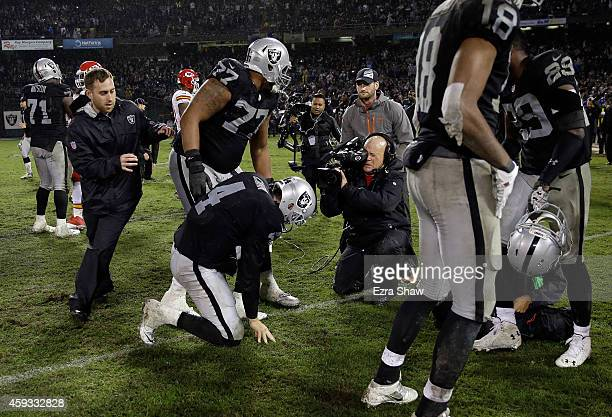 Derek Carr of the Oakland Raiders celebrates after the Raiders beat the Kansas City Chiefs for their first win of the season at Oco Coliseum on...