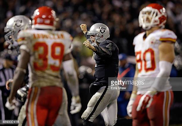 Derek Carr of the Oakland Raiders celebrates after throwing a touchdown pass to James Jones in the fourth quarter against the Kansas City Chiefs at...