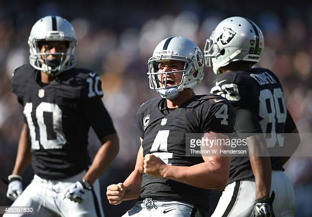 Derek Carr of the Oakland Raiders celebrates the game winning touchdown in the fourth quarter against the Baltimore Ravens at OaklandAlameda County...