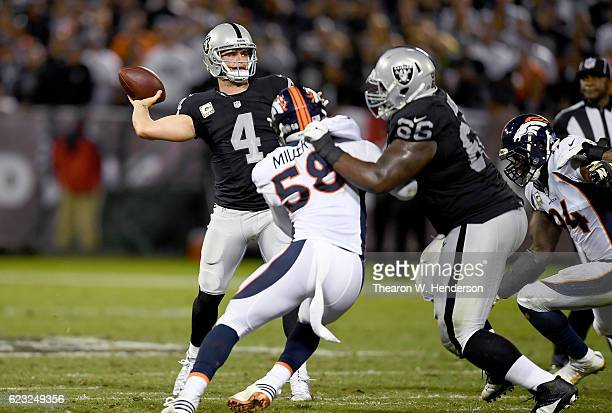 Derek Carr of the Oakland Raiders drops back to pass against the Denver Broncos in the second quarter of an NFL football game at the OaklandAlameda...