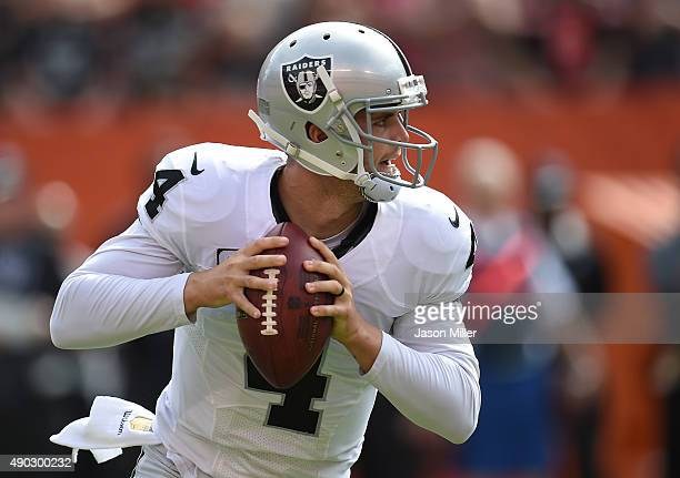 Derek Carr of the Oakland Raiders drops back to pass during the first quarter against the Cleveland Browns at FirstEnergy Stadium on September 27...