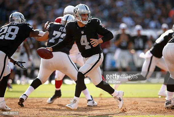 Derek Carr of the Oakland Raiders in action against the Arizona Cardinals at Oco Coliseum on August 30 2015 in Oakland California