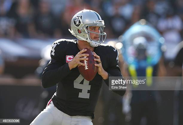 Derek Carr of the Oakland Raiders looks downfield in the fourth quarter against the Denver Broncos at Oco Coliseum on October 11 2015 in Oakland...