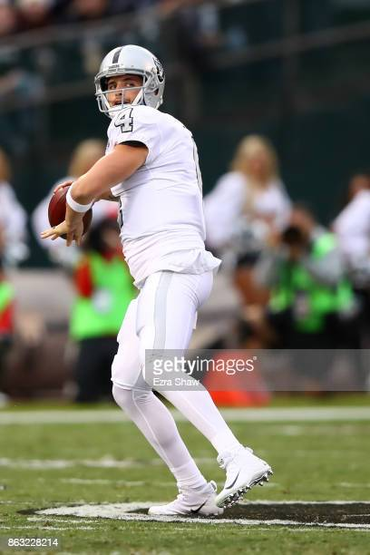 Derek Carr of the Oakland Raiders looks to pass against the Kansas City Chiefs during their NFL game at OaklandAlameda County Coliseum on October 19...
