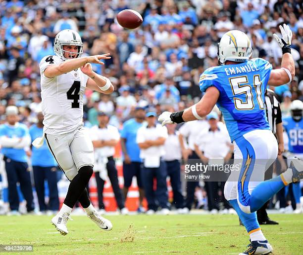 Derek Carr of the Oakland Raiders makes a pass on the run in front of Kyle Emanuel of the San Diego Chargers during the first quarter at Qualcomm...