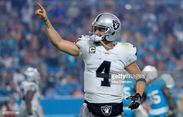 Derek Carr of the Oakland Raiders of the Oakland Raiders celebrates a touchdown during a game against the Miami Dolphins at Hard Rock Stadium on...