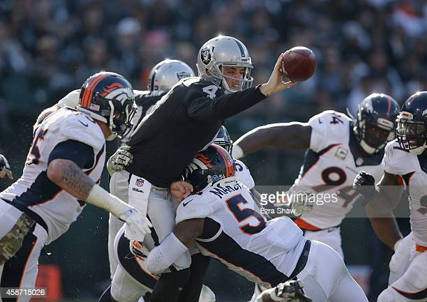 Derek Carr of the Oakland Raiders pitches the ball against the Denver Broncos in the third quarter at Oco Coliseum on November 9 2014 in Oakland...