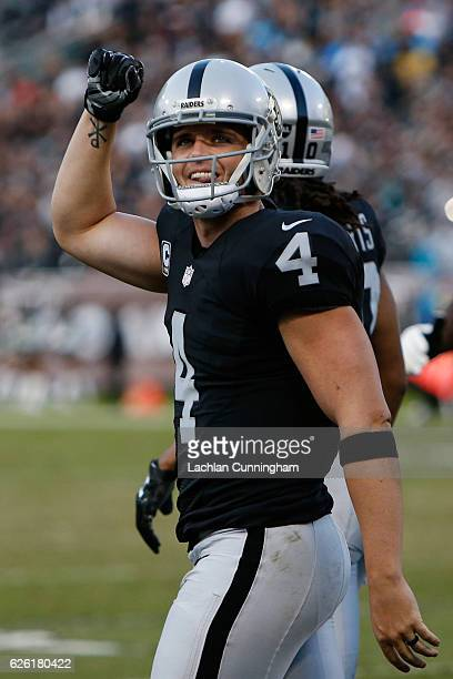 Derek Carr of the Oakland Raiders reacts after a successful twopoint conversion against the Carolina Panthers during their NFL game on November 27...