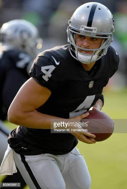 Derek Carr of the Oakland Raiders warms up during pregame warm ups prior to playing the Los Angeles Rams in an NFL preseason football game at...