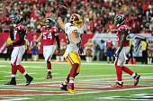 Derek Carrier of the Washington Redskins celebrates after scoring a 2nd quarter touchdown against the Atlanta Falcons at the Georgia Dome on October...