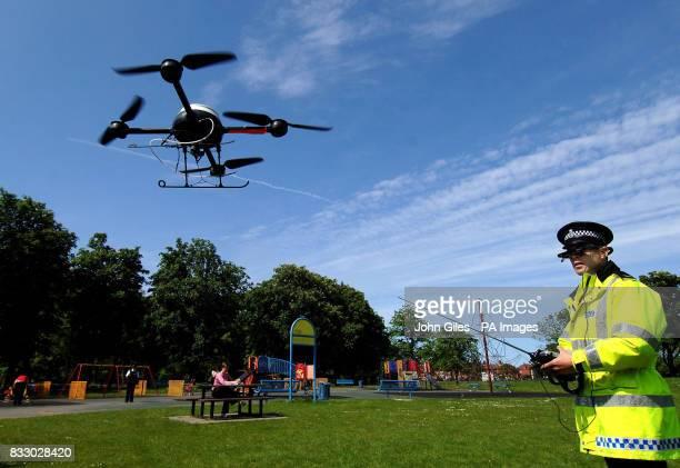 PC Derek Charlton of Merseyside Police operates their new aerial surveillance drone in Liverpool