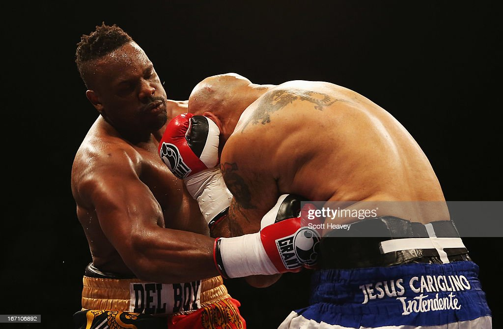 Derek Chisora (L) in action against Hector Avila during their International Heavyweight bout at Wembley Arena on April 20, 2013 in London, England.