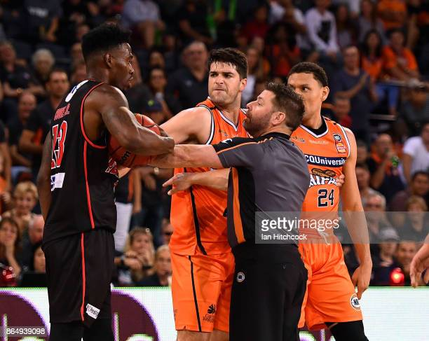 Derek Cooke Jr of the Wildcats is involved in a scuffle with Michael Carrera and Stephen Weigh of the Taipans during the round three NBL match...