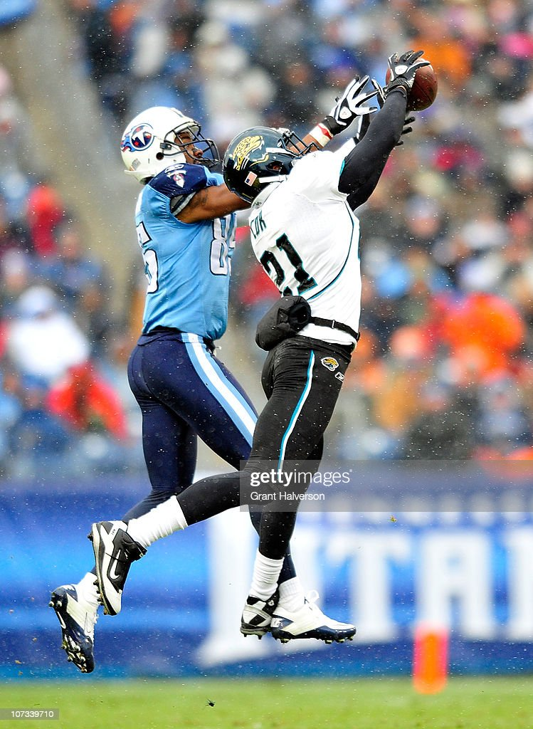 Derek Cox #21 of the Jacksonville Jaguars intercepts a pass intended for <a gi-track='captionPersonalityLinkClicked' href=/galleries/search?phrase=Nate+Washington&family=editorial&specificpeople=748657 ng-click='$event.stopPropagation()'>Nate Washington</a> #85 of the Tennessee Titans during the first half at LP Field on December 5, 2010 in Nashville, Tennessee.