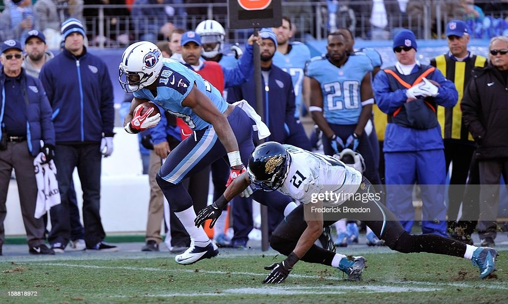 Derek Cox #21 of the Jacksonville Jaguars tackles <a gi-track='captionPersonalityLinkClicked' href=/galleries/search?phrase=Kenny+Britt&family=editorial&specificpeople=469830 ng-click='$event.stopPropagation()'>Kenny Britt</a> #18 of the Tennessee Titans at LP Field on December 30, 2012 in Nashville, Tennessee.