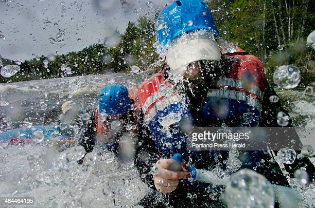 Diane Potter of Tauton Mass keeps paddling as a wave crashes over during a trip on the Dead River with Magic Falls Rafting Company May 27 2007 The...