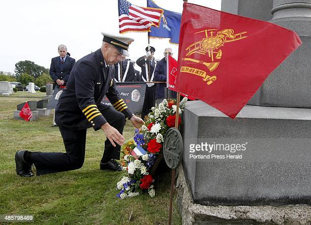 Robert Wassick deputy chief of the Portland Fire Department lays a wreath beside Portland Veteran Firemenu2019s Monument during a ceremony in Forest...