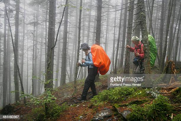 Shirley Gamble of St Petersburg Florida and Arlene Petty of Ava Missouri hike on the Appalachian Trail Wednesday July 11 after coming across...