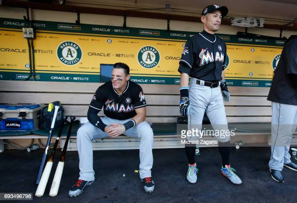 Derek Dietrich and Ichiro Suzuki of the Miami Marlins relax in the dugout prior to the game against the Oakland Athletics at the Oakland Alameda...