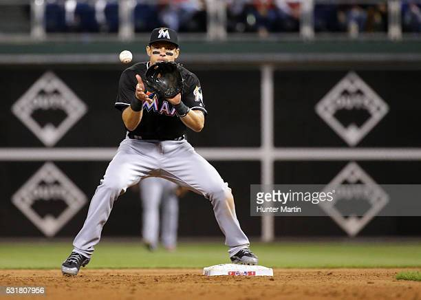 Derek Dietrich of the Miami Marlins catches a force out at second base in the seventh inning during a game against the Philadelphia Phillies at...