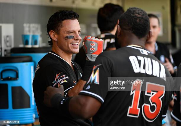 Derek Dietrich of the Miami Marlins celebrates his solo home run with Marcell Ozuna in the fourth inning during the game against the Pittsburgh...