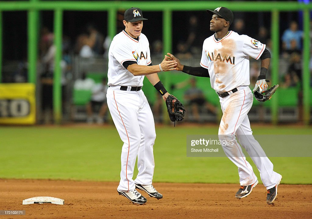 Derek Dietrich #51 of the Miami Marlins celebrates with <a gi-track='captionPersonalityLinkClicked' href=/galleries/search?phrase=Adeiny+Hechavarria&family=editorial&specificpeople=6926508 ng-click='$event.stopPropagation()'>Adeiny Hechavarria</a> #3 of the Miami Marlins after defeating the San Diego Padres 4-0 at Marlins Park on July 1, 2013 in Miami, Florida.