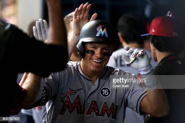 Derek Dietrich of the Miami Marlins celebrates with teammates after hitting a home run in the seventh inning a Milwaukee Brewers at Miller Park on...