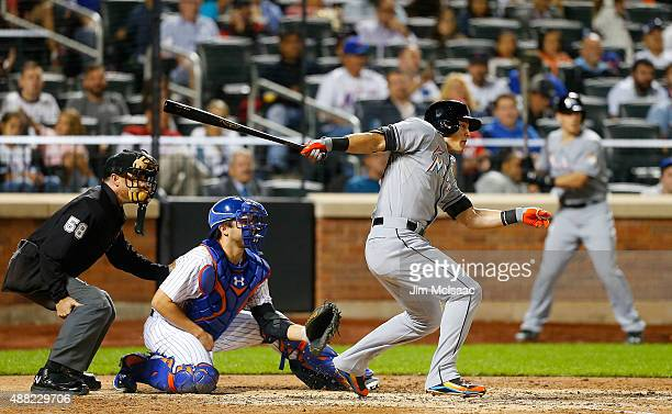 Derek Dietrich of the Miami Marlins follows gets a sixthinning RBI base hit against the New York Mets at Citi Field on September 14 2015 in the...