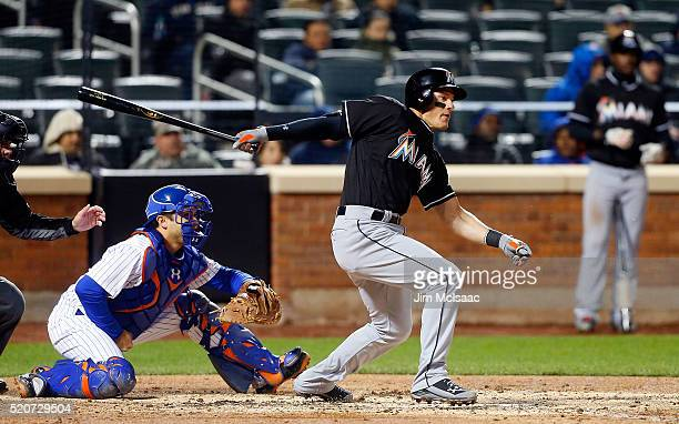 Derek Dietrich of the Miami Marlins follows through on a fourth inning RBI base hit against the New York Mets at Citi Field on April 12 2016 in the...