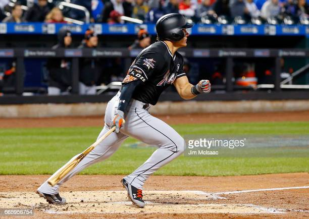 Derek Dietrich of the Miami Marlins follows through on a second inning two run triple against the New York Mets at Citi Field on April 7 2017 in the...