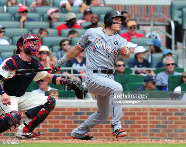 Derek Dietrich of the Miami Marlins hits a sixth inning double against the Atlanta Braves at SunTrust Park on August 6 2017 in Atlanta Georgia