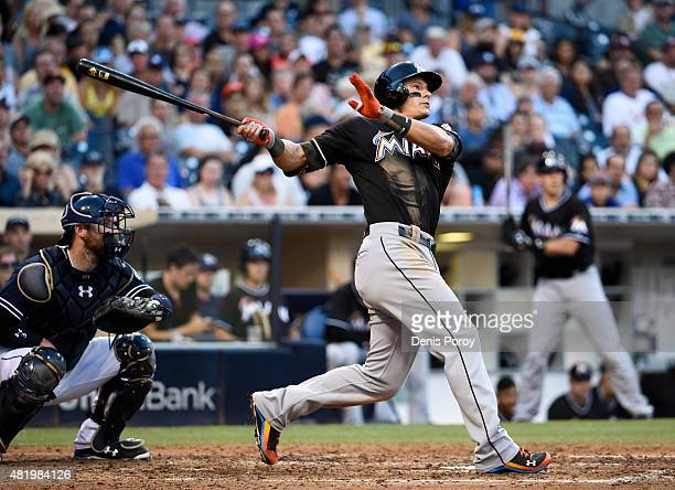 Derek Dietrich of the Miami Marlins hits a solo home run during the seventh inning of a baseball game against the San Diego Padres at Petco Park July...