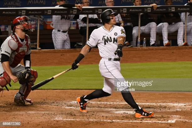Derek Dietrich of the Miami Marlins hits a two run home run in the sixth inning against the Philadelphia Phillies at Marlins Park on May 29 2017 in...