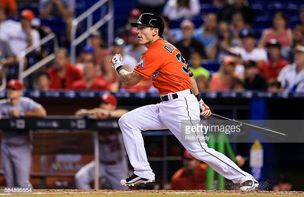 Derek Dietrich of the Miami Marlins hits a walkoff triple during the ninth inning of the game against the St Louis Cardinals at Marlins Park on July...