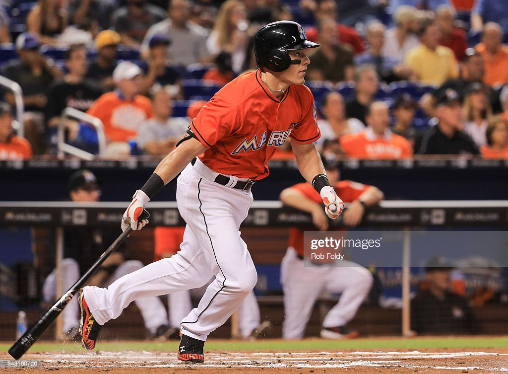 Derek Dietrich #32 of the Miami Marlins hits an RBI double during the second inning of the game against the Chicago Cubs at Marlins Park on June 26, 2016 in Miami, Florida.