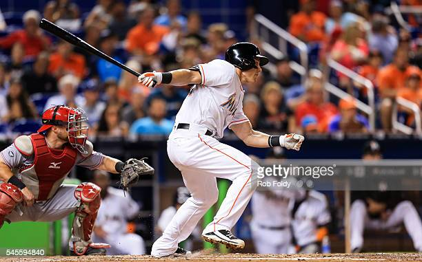 Derek Dietrich of the Miami Marlins hits an RBI single to score Christian Yelich during the fourth inning of the game against the Cincinnati Reds at...