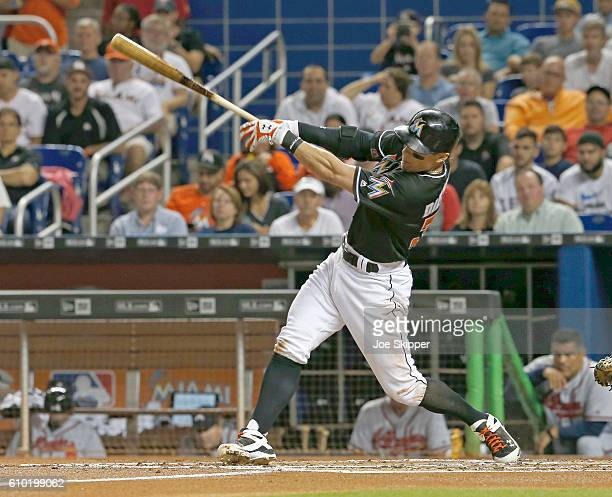 Derek Dietrich of the Miami Marlins hits Atlanta Braves tworun home run in the first inning against the Atlanta Braves at Marlins Park on September...