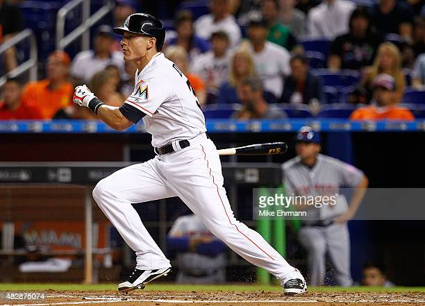Derek Dietrich of the Miami Marlins hits during a game against the New York Mets at Marlins Park on August 3 2015 in Miami Florida
