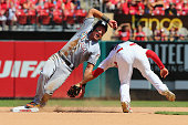 Derek Dietrich of the Miami Marlins is caught stealing second base in the seventh inning at Busch Stadium on August 16 2015 in St Louis Missouri