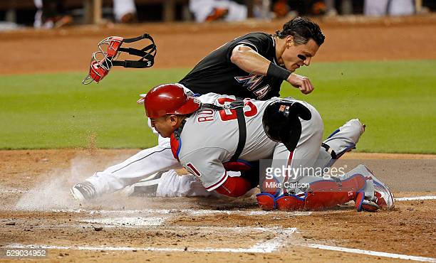 Derek Dietrich of the Miami Marlins is tagged out at home by Carlos Ruiz of the Philadelphia Phillies during the fifth inning of a game at Marlins...