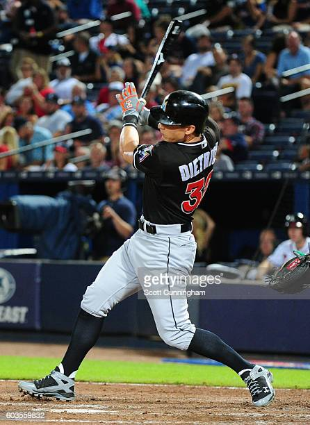 Derek Dietrich of the Miami Marlins knocks in a run with a third inning single against the Atlanta Braves at Turner Field on September 12 2016 in...