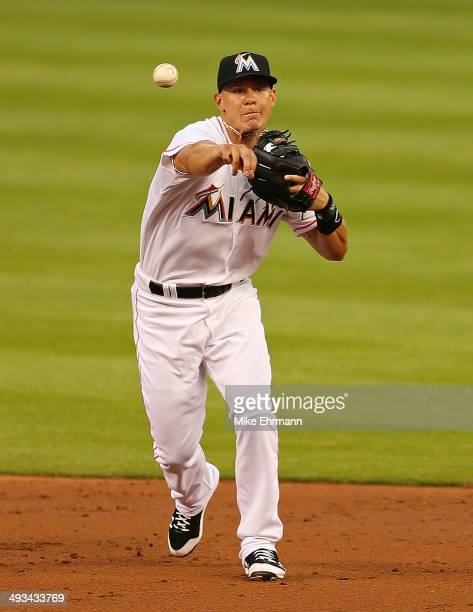 Derek Dietrich of the Miami Marlins makes a throw to first during a game against the Milwaukee Brewers at Marlins Park on May 23 2014 in Miami Florida