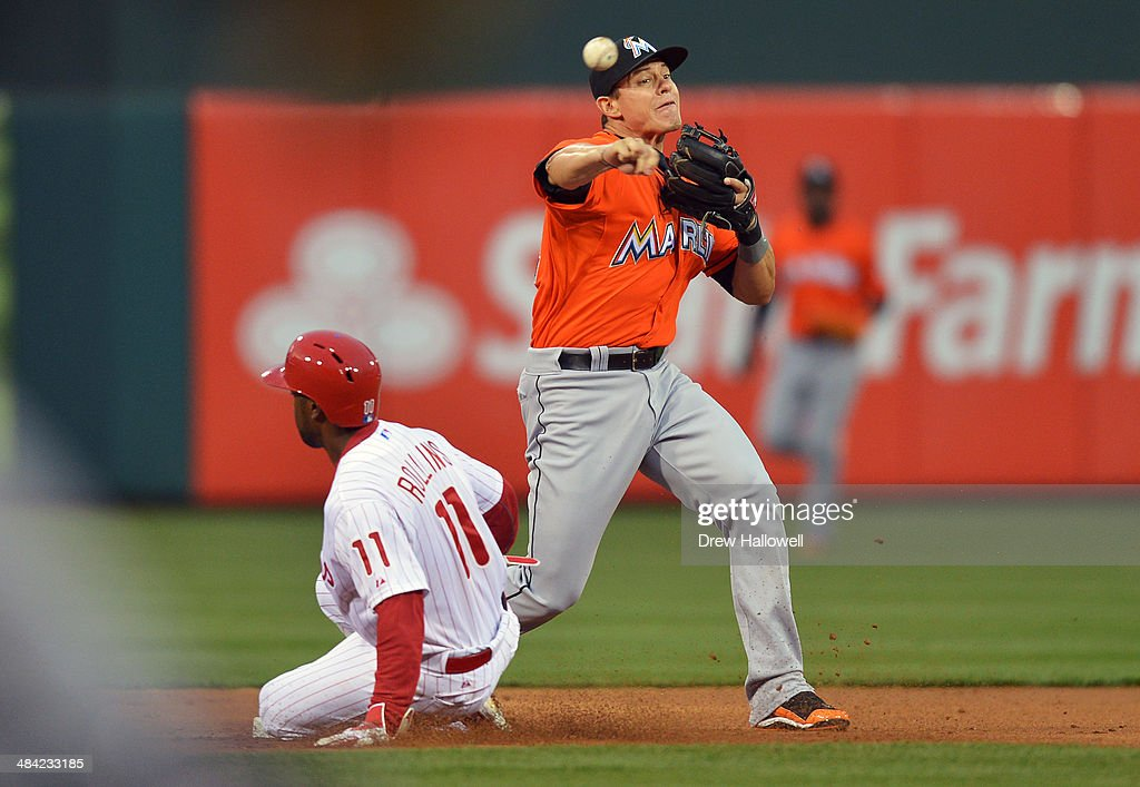 <a gi-track='captionPersonalityLinkClicked' href=/galleries/search?phrase=Derek+Dietrich&family=editorial&specificpeople=10507746 ng-click='$event.stopPropagation()'>Derek Dietrich</a> #32 of the Miami Marlins puts out <a gi-track='captionPersonalityLinkClicked' href=/galleries/search?phrase=Jimmy+Rollins&family=editorial&specificpeople=204478 ng-click='$event.stopPropagation()'>Jimmy Rollins</a> #11 of the Philadelphia Phillies on an attempted double play in the first inning at Citizens Bank Park on April 11, 2014 in Philadelphia, Pennsylvania.