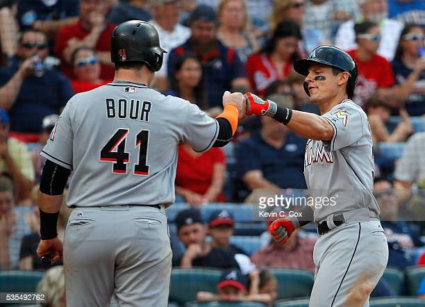 Derek Dietrich of the Miami Marlins reacts after hitting a tworun homer in the sixth inning against the Atlanta Braves that scored Justin Bour at...