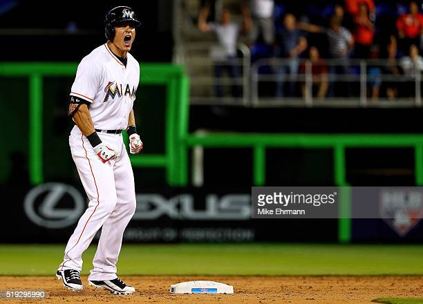 Derek Dietrich of the Miami Marlins reeacts to an RBI double in the ninth inning during 2016 Opening Day against the Detroit Tigers at Marlins Park...