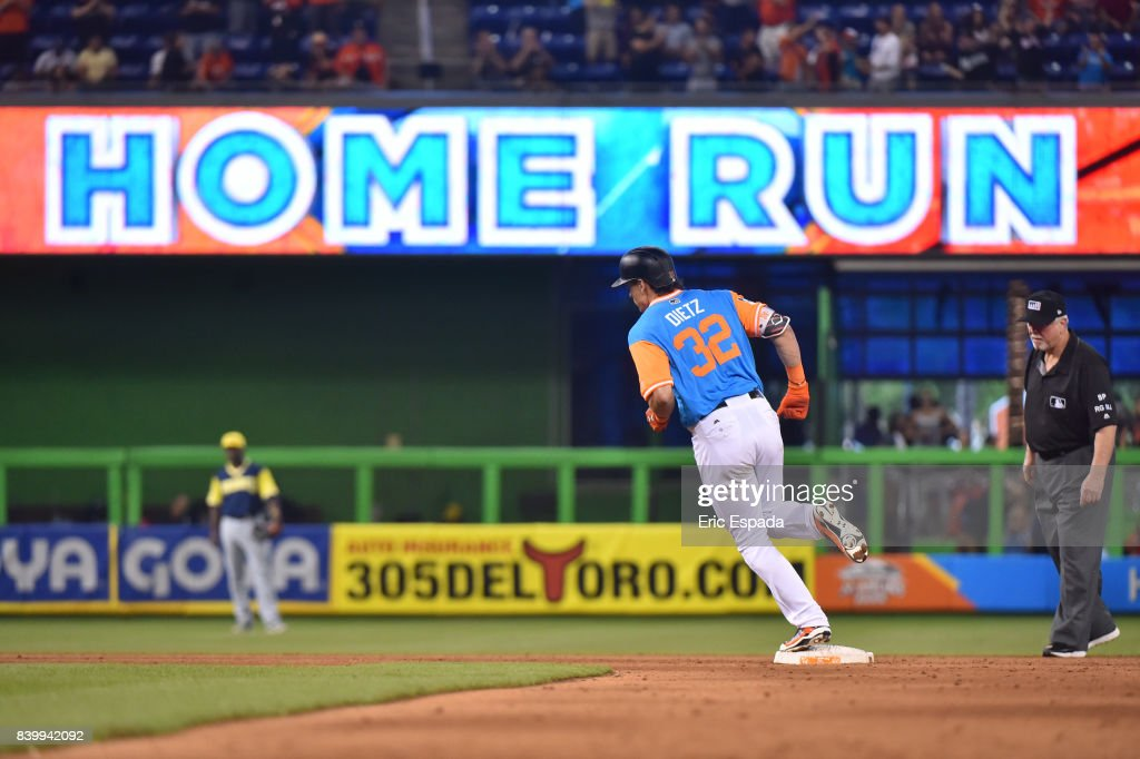 Derek Dietrich #32 of the Miami Marlins rounds second base after hitting a home run in the eighth inning against the San Diego Padres at Marlins Park on August 27, 2017 in Miami, Florida.