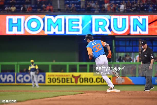 Derek Dietrich of the Miami Marlins rounds second base after hitting a home run in the eighth inning against the San Diego Padres at Marlins Park on...