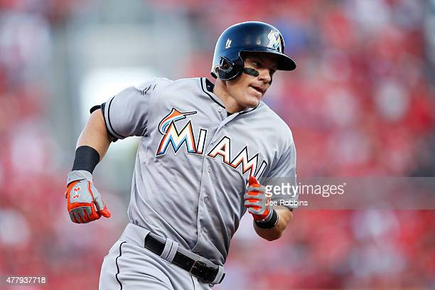Derek Dietrich of the Miami Marlins rounds the bases after hitting a solo home run in the fourth inning against the Cincinnati Reds at Great American...